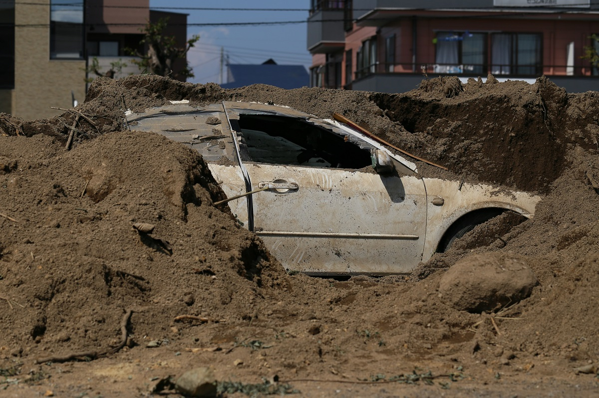 Hurricane Sandy surge left cars buried in sand in the streets